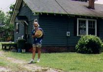 Dan Barth, hat in hand, in front of Blake House